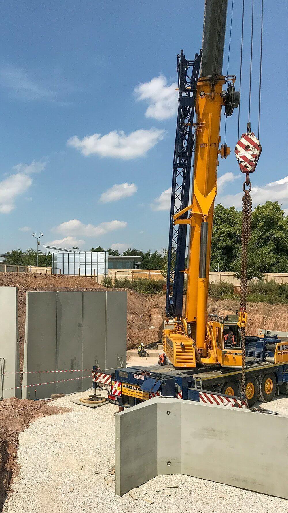 Retaining wall crane installation